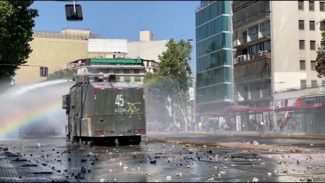 demonstrators clash with security forces in santiago, chile on october 30, 2019. at least 20 people were killed in violent protests against rising... - chile stock videos & royalty-free footage