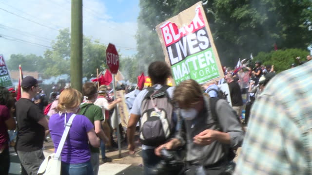 "demonstrators clashed on the streets of charlottesville ahead of the ""unite the right"" rally on aug. 12, 2017 as white nationalists and other... - political rally stock videos & royalty-free footage"