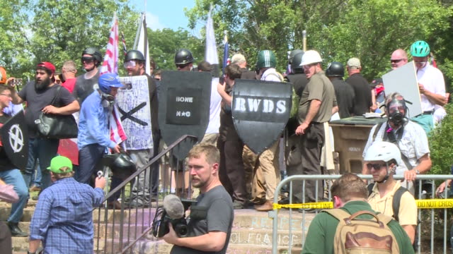 "wtvr demonstrators clashed on the streets of charlottesville ahead of the ""unite the right"" rally on aug 12 2017 as white nationalists and other... - confrontation stock videos & royalty-free footage"