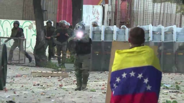 demonstrators clashed with police as venezuela's opposition began a two day nationwide strike on wednesday aimed at ousting president nicolas maduro... - venezuela stock videos & royalty-free footage