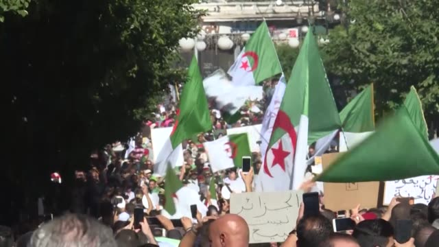 demonstrators converge on algiers for a mass rally called by protest leaders to coincide with official celebrations of the anniversary of the war... - independence stock videos & royalty-free footage