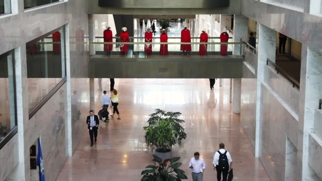 Demonstrators dressed as characters from 'The Handmaid's Tale' protest outside the hearing room where Supreme Court nominee Judge Brett Kavanaugh was...