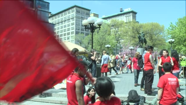 demonstrators gather and prepare to march down broadway on international workers day, or labor day, on may 1, 2014 in new york city. - day 1 stock videos & royalty-free footage