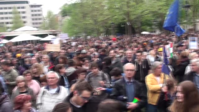 demonstrators gather at liberty square to attend a protest dubbed we won't stay silent against government policies in budapest hungary on april 15... - budapest stock-videos und b-roll-filmmaterial