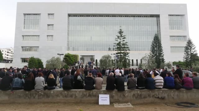demonstrators gather during a protest by bank workers outside the cypriot central bank in nicosia cyprus bank workers demonstrate in nicosia on march... - キプロス ニコシア点の映像素材/bロール