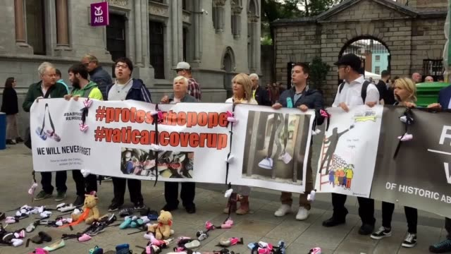 demonstrators gather in dublin to protest against the pope's visit to ireland because of widespread clerical abuse in the country - catholicism stock videos and b-roll footage