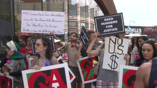 demonstrators gather in front of the barclay center in brooklyn just before their march to protest israel's actions in gaza / focus on signs and... - judaism stock videos & royalty-free footage
