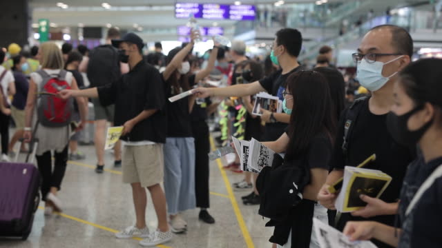 demonstrators gather in the arrival hall during a protest at the hong kong international airport in hong kong, china, on friday, aug. 9, 2019. hong... - hong kong international airport stock videos & royalty-free footage