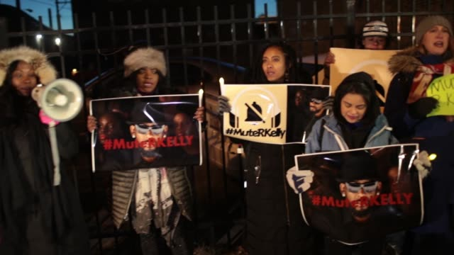 demonstrators gather near the studio of singer r. kelly to call for a boycott of his music after allegations of sexual abuse against young girls were... - r. kelly stock videos & royalty-free footage