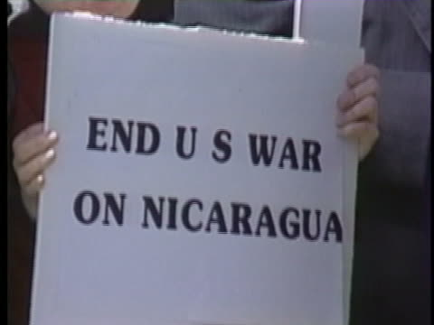 demonstrators gather on the steps of the capitol to show their disapproval of continued aid to the contras in nicaragua. - ニカラグア点の映像素材/bロール