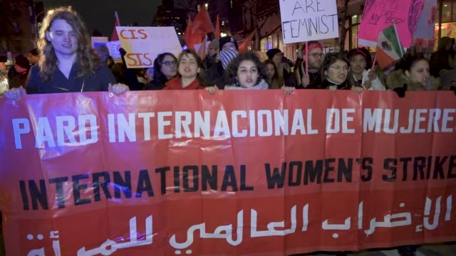 demonstrators gathered and rallied in manhattan's washington square park for the international women's strike new york city 2018. after the rally... - spruchband stock-videos und b-roll-filmmaterial