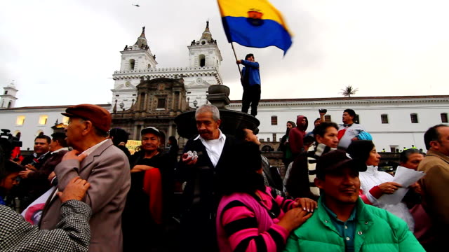 demonstrators gathered in colonial town of quito against labor reforms of ecuadorian president rafael correa - ecuadorian ethnicity stock videos and b-roll footage
