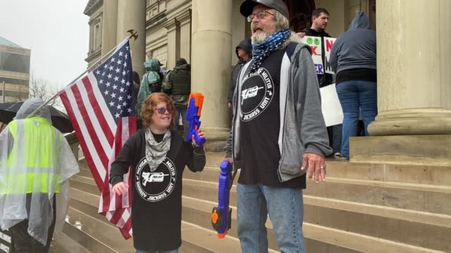demonstrators hold a rally in front of the michigan state capital building to protest the governor's stayathome order on may 14 2020 in lansing... - lansing stock videos & royalty-free footage