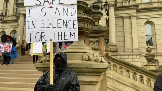 demonstrators hold a rally in front of the michigan state capital building to protest the governor's stay-at-home order on may 14, 2020 in lansing,... - lansing stock videos & royalty-free footage