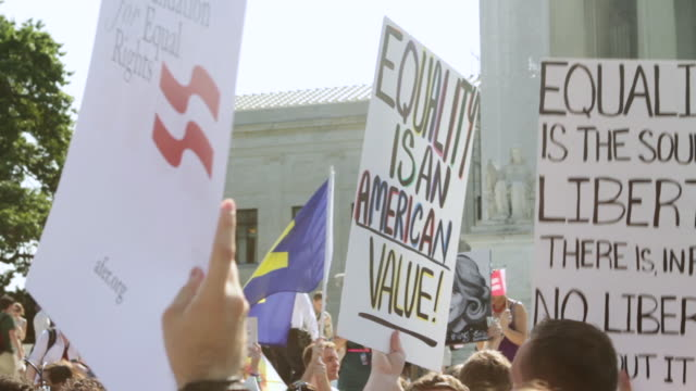 ms demonstrators holding out signs in favor of marriage equality during rally in front of supreme court building / washington, district of columbia, united states - supreme court stock videos & royalty-free footage