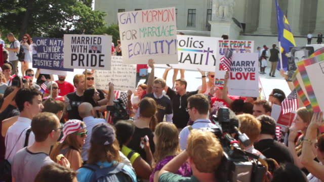 MS Demonstrators holding out signs in favor of marriage equality during rally in front of Supreme Court building / Washington, District of Columbia, United States