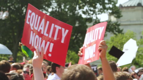 cu demonstrators holding up equality now signs during rally for marriage equality / washington, district of columbia, united states - diritti lgbtqi video stock e b–roll