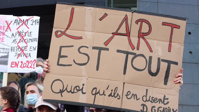 """vidéos et rushes de demonstrators in the cultural sector hold a sign """"art is everything"""" during a demonstration in front of the opera bastille to protest against... - french culture"""