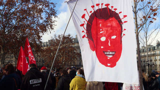 vidéos et rushes de demonstrators in the cultural sector hold a sign with a caricature of president emmanuel macron with the shape of the coronavirus virus, during a... - french culture
