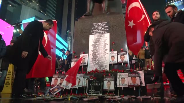 demonstrators including nypd officers attend a memorial event at times square in new york on december 17 2016 to pay tribute to the 37 turkish police... - tribute event stock videos & royalty-free footage