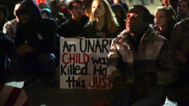 demonstrators listen to a speaker during a protest against the grand jury's decision outside the white house november 25 washington dc hundreds of... - darren day stock videos & royalty-free footage