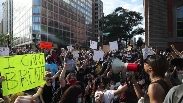 demonstrators listen to a speech during a protest near lafayette square park on may 30 2020 in washington dc across the country protests were set off... - lafayette square washington dc stock videos & royalty-free footage