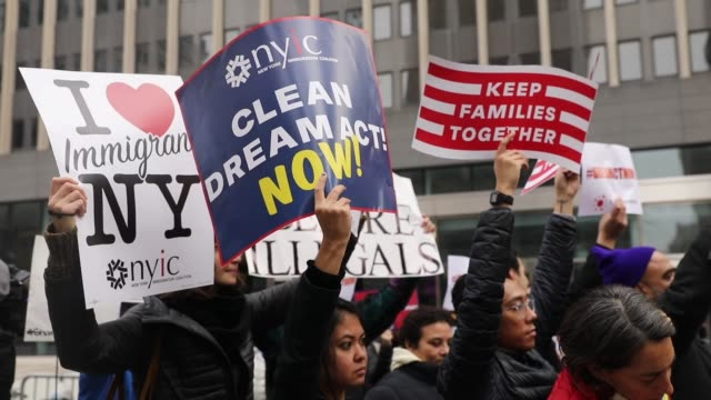 demonstrators, many of them recent immigrants to america, protest the government shutdown and the lack of a deal on daca outside of federal plaza on... - mexican american stock videos & royalty-free footage