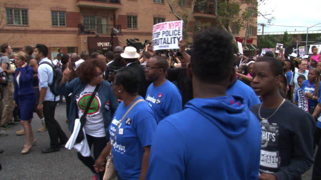 demonstrators march and chant in protest at the we will not go back march for justice march and rally to protest the chokehold death of eric garner /... - al sharpton stock videos & royalty-free footage