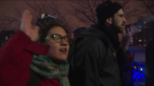 demonstrators march at night in chicago protesting against police shootings and the darren wilson ferguson grand jury ruling on nov 25 2014 - police brutality stock videos and b-roll footage
