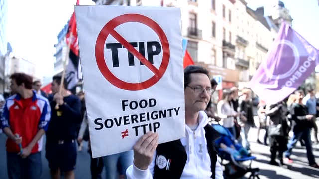 Demonstrators march during a protest against the Transatlantic Trade and Investment Partnership a proposed free trade agreement between the European...