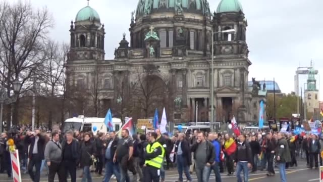 demonstrators march during a rally organized by german political party 'alternative fuer deutschland' to protest the german government's refugee... - 2015 stock-videos und b-roll-filmmaterial