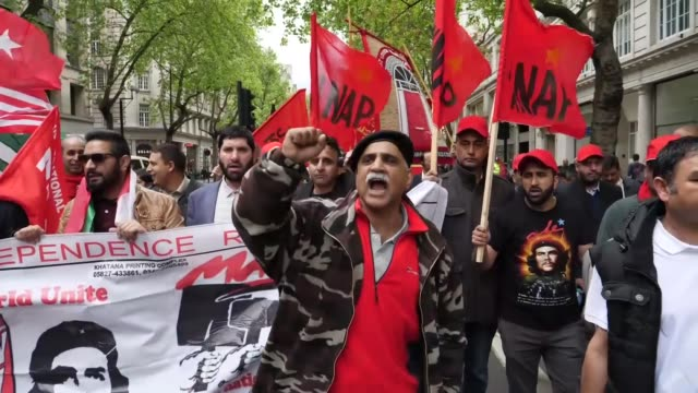 demonstrators march from clerkenwell green to trafalgar square during a may day rally in london england on may 01 2017 - may day international workers day stock videos & royalty-free footage