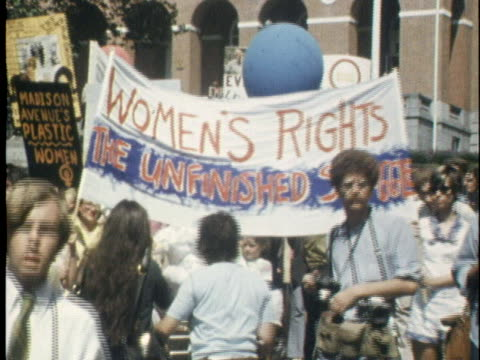 demonstrators march in a women's liberation parade in boston, massachusetts. - boston massachusetts stock videos & royalty-free footage