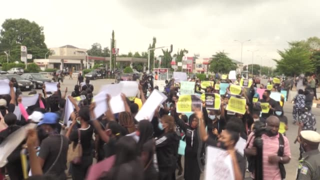 demonstrators march in the nigerian capital of abuja demanding an end to gender-based and sexual violence - sexual violence stock videos & royalty-free footage