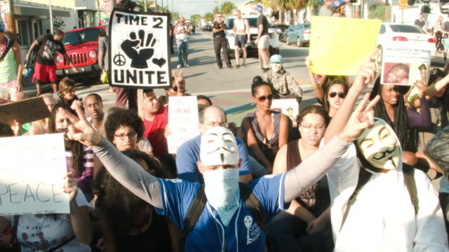 Demonstrators march through the Wynwood neighborhood and along Interstate 195 to protest police abuse on December 7 2014 in Miami Florida The protest...