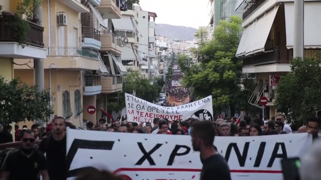 demonstrators march to the office of golden dawn party in piraeus during a rally to mark the fifth death anniversary of greek rapper pavlos fissas... - molotov cocktail stock videos and b-roll footage