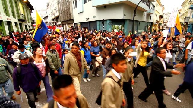 vídeos y material grabado en eventos de stock de demonstrators marched in colonial town of quito against labor reforms of ecuadorian president rafael correa - ecuador