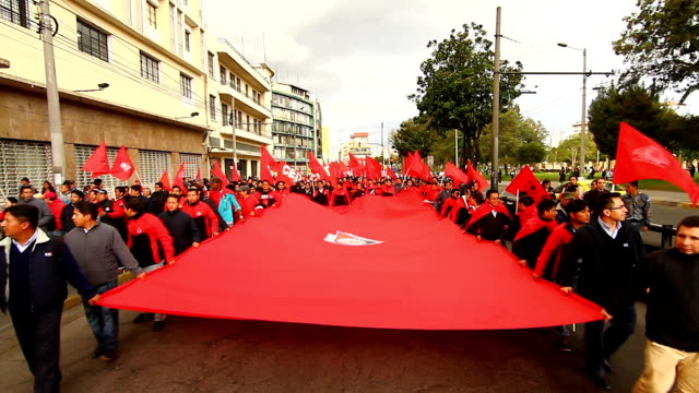 demonstrators marched in colonial town of quito holding a huge red flag against labor reforms of ecuadorian president rafael correa - ecuadorian ethnicity stock videos & royalty-free footage