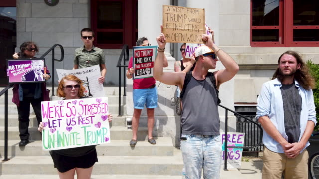 demonstrators outside of the dayton city hall protest a planned visit of president donald trump on august 06, 2019 in dayton, ohio. trump is... - dayton ohio stock videos & royalty-free footage