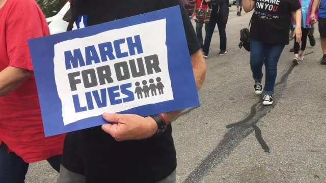 demonstrators participate in a march for our lives rally on march 24 2018 in round rock texas more than 800 march for our lives events organized by... - march for our lives stock videos and b-roll footage
