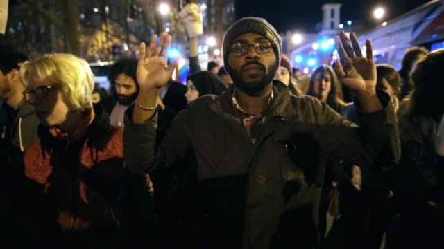 stockvideo's en b-roll-footage met demonstrators participate in a march to protest against the grand jury's decision november 25 washington dc hundreds of demonstrators gather at mt... - black lives matter