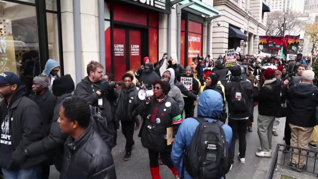 demonstrators participate in an anti-black friday protest on michigan avenue on november 25, 2016 in chicago, illinois. protesters gathered along... - 2016 stock videos & royalty-free footage