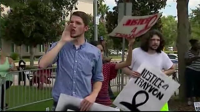 demonstrators protest against george zimmerman's acquittal outside of the sanford florida courthouse where he was acquitted of the murder of trayvon... - crime or recreational drug or prison or legal trial stock-videos und b-roll-filmmaterial