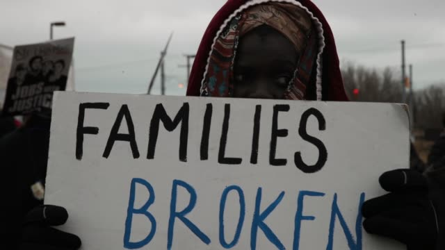 stockvideo's en b-roll-footage met demonstrators protest deportations at garychicago airport on february 23 2018 in gary indiana immigrants from wisconsin indiana and illinois are... - deportation