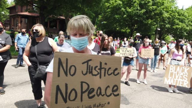 demonstrators protest police brutality outside of the governor's mansion following the death of george floyd on june 06, 2020 in st. paul, minnesota.... - b rolle stock-videos und b-roll-filmmaterial