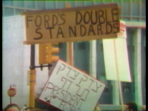 demonstrators protest us president gerald ford's decision to pardon president richard nixon. - resignation of richard nixon stock videos & royalty-free footage
