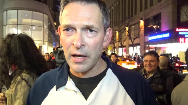 Demonstrators protesting outside of the NBC Rainbow Room on Rockefeller Plaza / On camera is Brent Wilkes / The ANSWER Coalition and the NYS Youth...