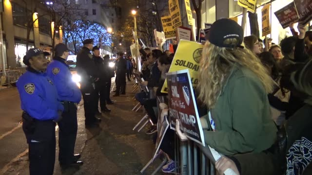demonstrators protesting outside of the nbc rainbow room on rockefeller plaza / the answer coalition and the nys youth leadership council sponsored a... - an answer film title stock videos & royalty-free footage