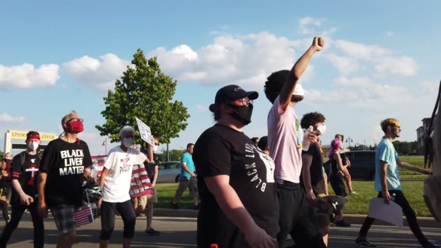 demonstrators protesting the shooting of jacob blake march through a neighborhood on august 27 2020 in kenosha wisconsin blake was shot seven times... - back to front stock videos & royalty-free footage
