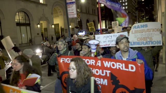 demonstrators rallied at 23rd street and 5th avenue and marched to grand central station in opposition to president donald trump's administration... - mixed gender stock videos & royalty-free footage